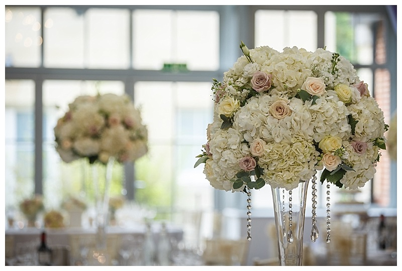 tall vintage pink and ivory wedding flowers table centrepieces.
