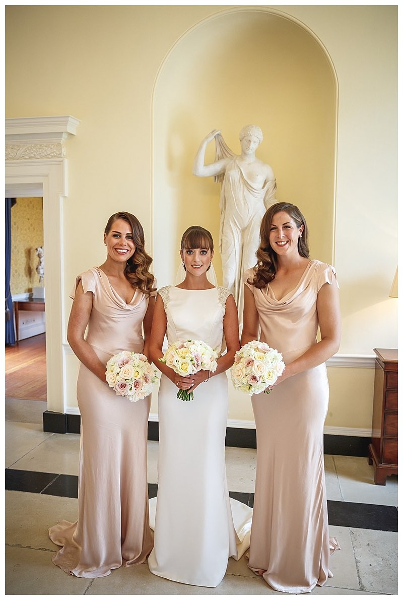 champagne blush pink bridesmaids dresses with ivory and nude pink bridesmaids bouquets, from wedding at Botleys Mansion.