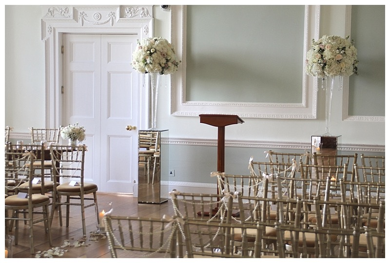 tall ceremony flowers centrepieces on glamorous mirrored plinth stands pedestals from wedding at Hotkeys Mansion.