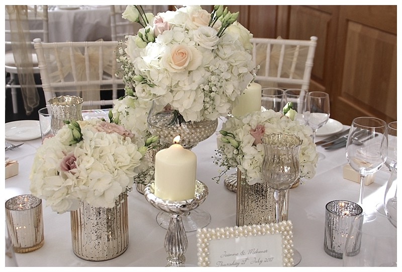silver and blush wedding flowers, cluttered table centrepiece with hydrangeas and roses.