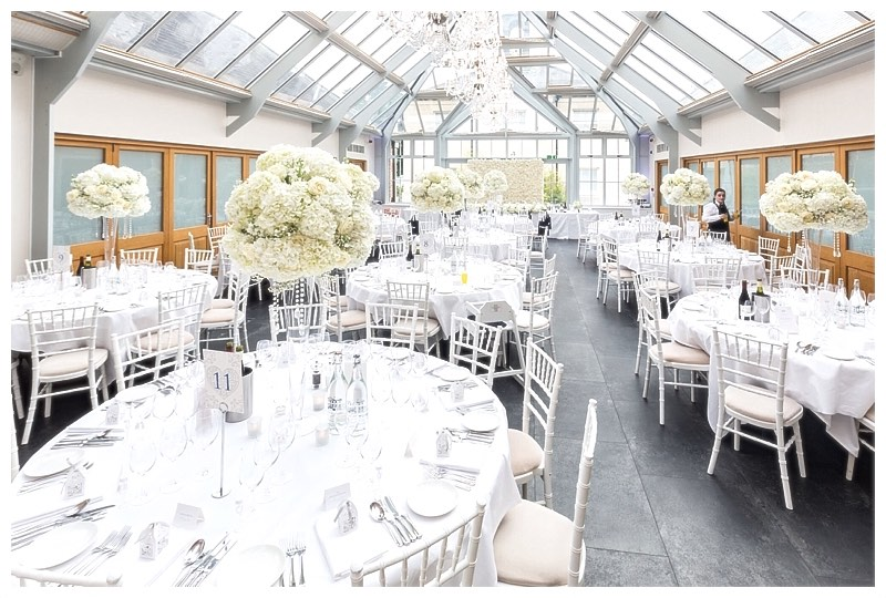 tall white modern wedding flowers centrepieces at Botleys Mansion in Surrey.