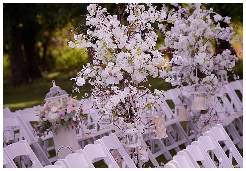 blossom flowers trees at surrey wedding at Great fosters, in the outdoor garden.