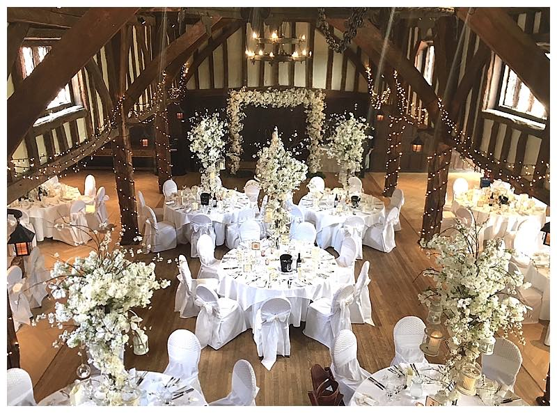 surrey barn wedding flowers - tithe barn at great fosters in surrey.