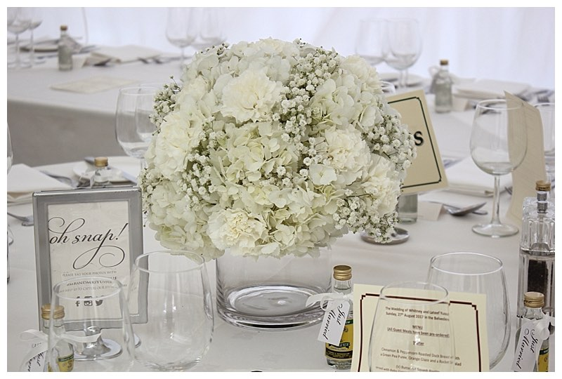 all white wedding flowers low vase display centrepiece with hydrangeas and gypsophila.