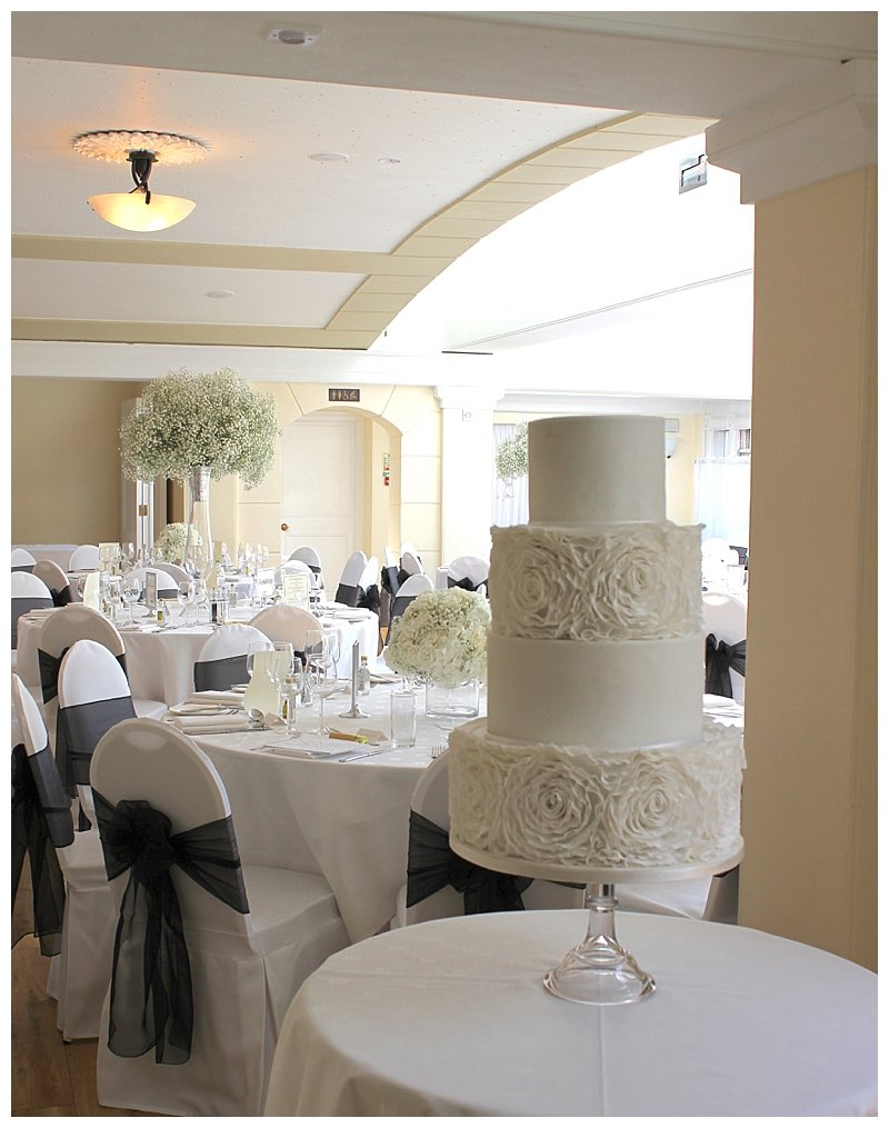 frill wedding cake and gypsophila table displays at pembroke lodge in surrey