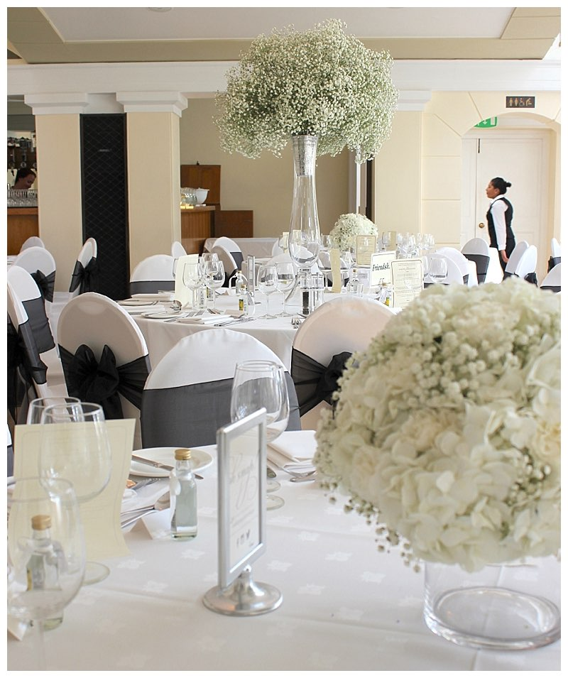 tall and low table centrepieces of gypsophila ,hydrangeas and carnations