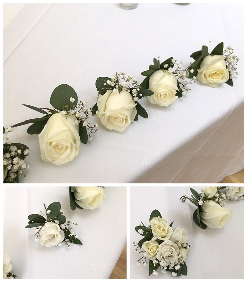 white rose buttonholes with gypsophila