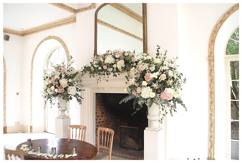 northbrook park wedding flowers ceremony flower displays, tall urn centrepieces with wild informal wedding flowers.