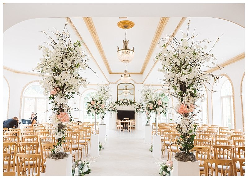 wedding ceremony aisle at Northbrook park, with tall cherry blossom flower trees. Wedding florist at Northbrook park