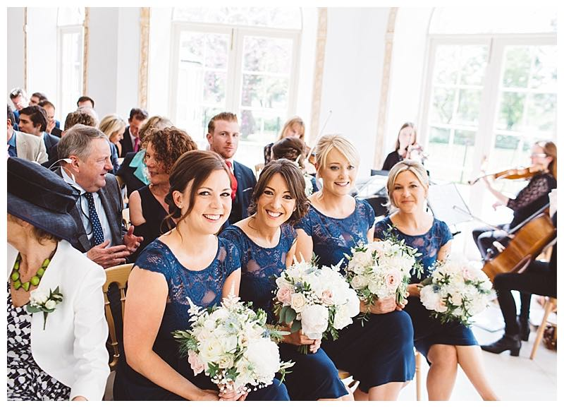 ivory, blush and hint of pale blue bridesmaids bouquets with roses, peonies, nigella, astilbe and eucalyptus. Navy bridesmaids dresses with wild bouquets.