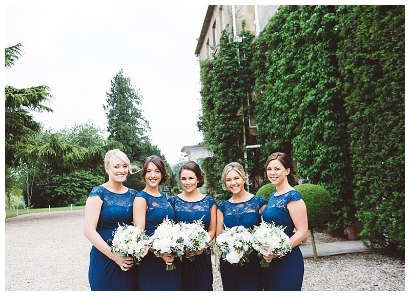 navy blue bridesmaids dresses with bridesmaids bouquets of ivory and blush flowers - roses, peonies, astilbe, gypsophila. Relaxed informal bouquets.
