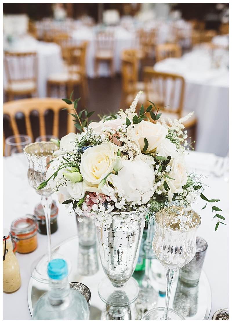 low silver vase with ivory and pastel pink flowers bouquet