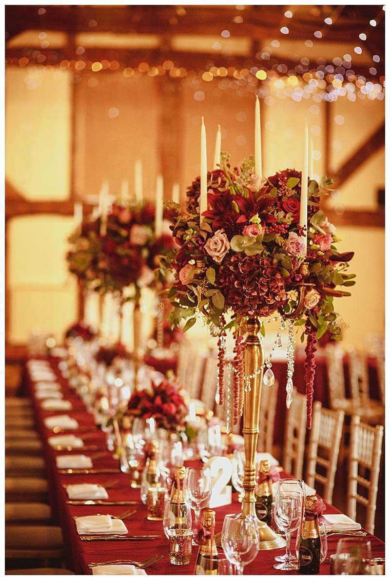 opulent candelabra wedding table centrepieces , barn wedding flowers, loseley wedding in guildford, Loseley florist.