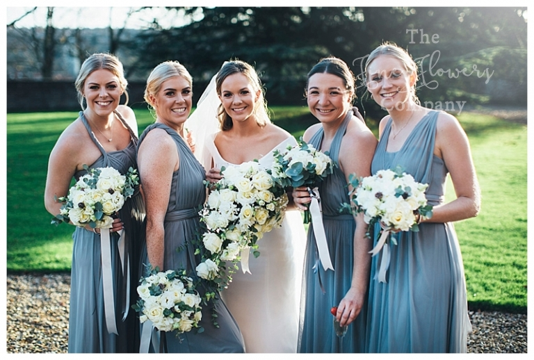 silver grey wedding bouquets. Bridal tear drop bouquet and bridesmaids white and silver bouquets.