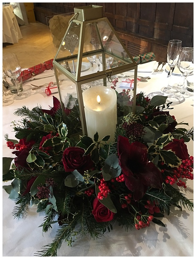 geometric lantern floral wreath centrepiece, with red grand prix roses, skimmer and red berries and winter foliage