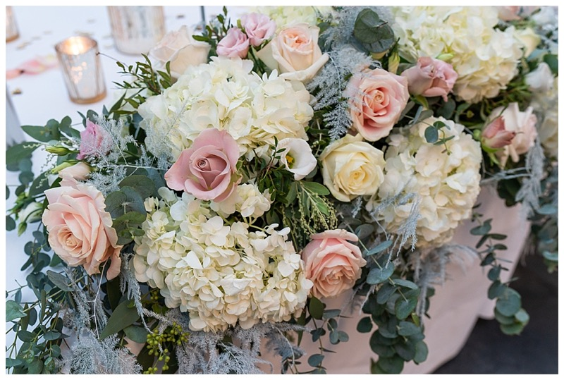 ivory and nude pink wedding flowers with winter foliage.
