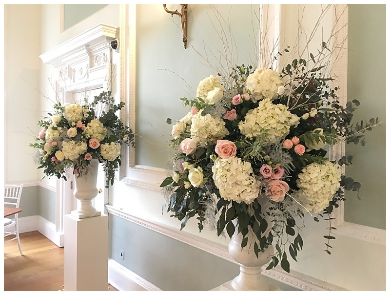 ivory and blush pink focal urn centrepieces - ceremony wedding flowers display