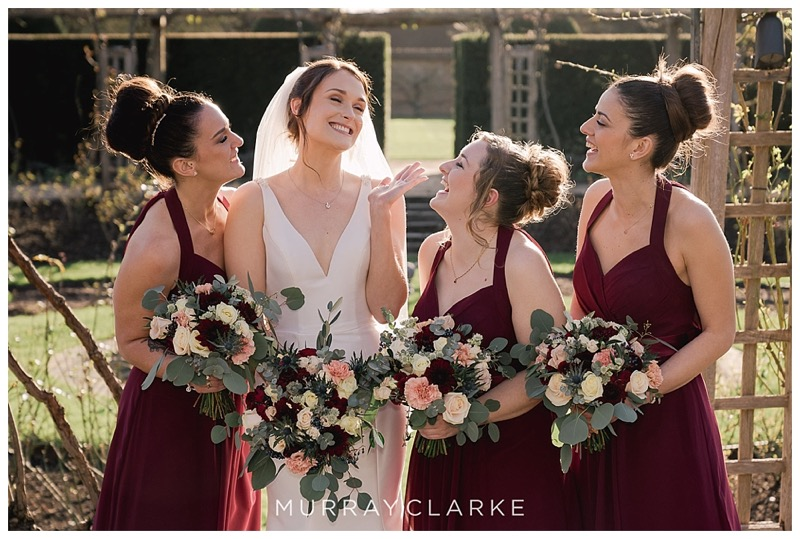 winter wedding flowers at gReat Fosters, burgundy plum bridesmaids dresses